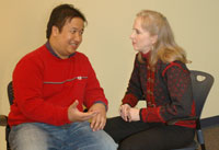 Reiki practitioner and man talking