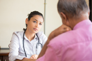 doctor listening to patient talk