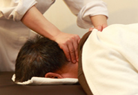 Shiatsu massage of neck and shoulders