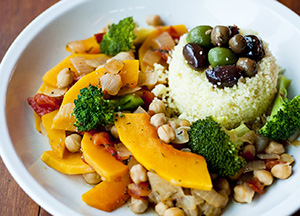 healthy plate of food, including rice, nuts, and vegetables