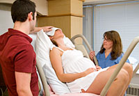 pregnant woman resting between labor contractions