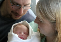 parents with newborn baby