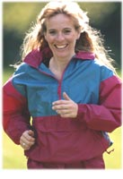 woman jogging, smiling