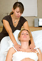 pregnant woman receiving healing touch therapy