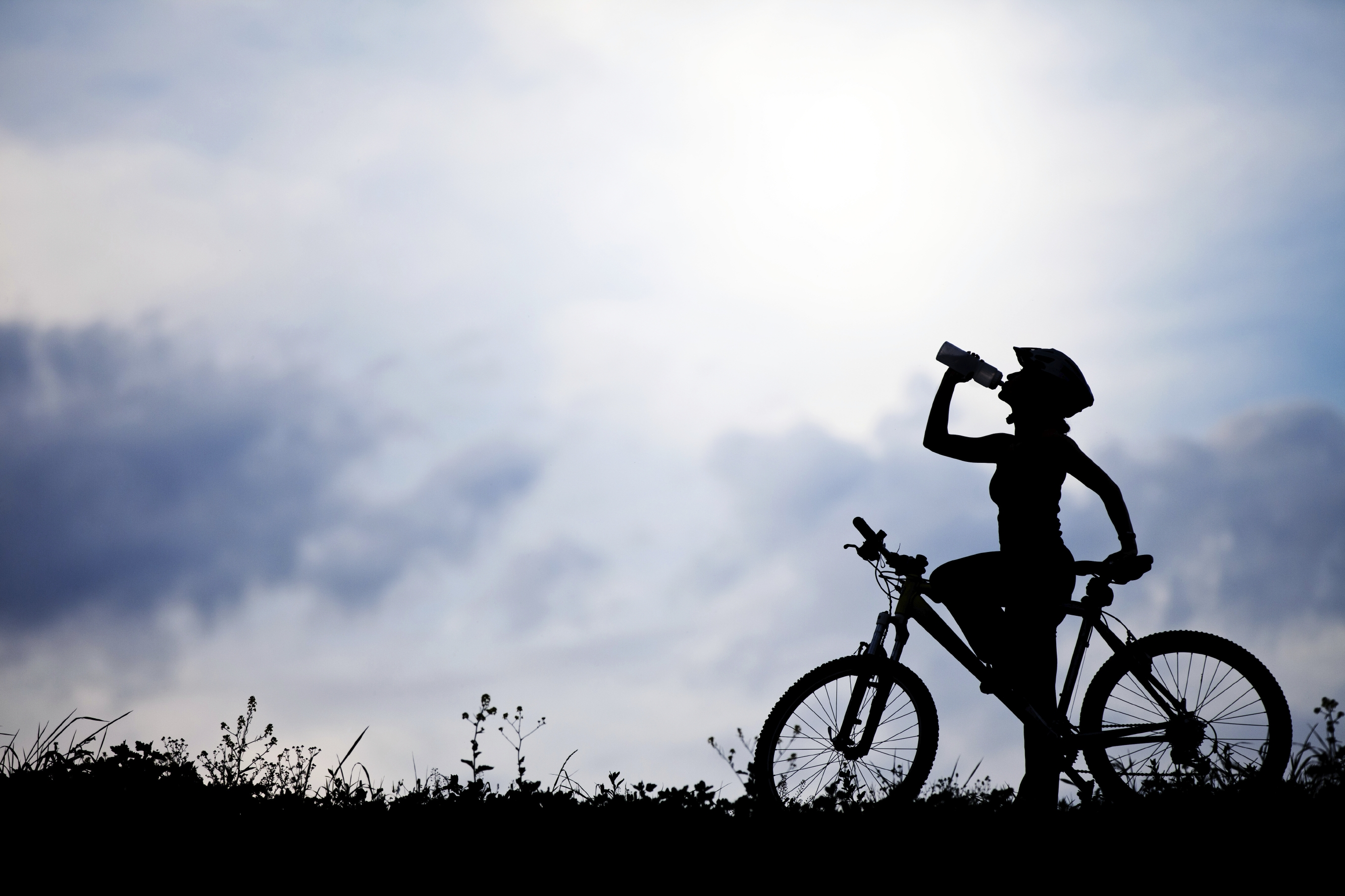 Bicyclist pausing for water