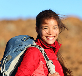 Smiling young woman hiking.