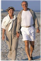 Older couple walking on the beach