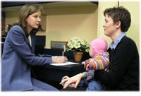 Mother with child talking with chiropracter