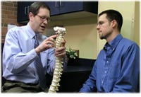 Chiropractor discussing treatment
