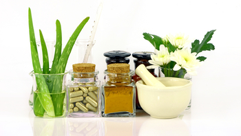 various natural therapies, including plants and herbs, against a white background