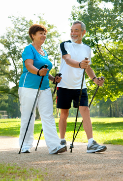 senior couple nordic walking outside