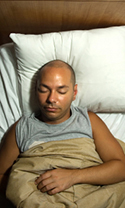 view from above of a man sleeping in bed