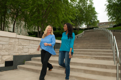 two women walking down outdoor steps together