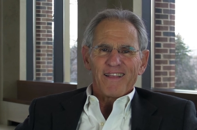 Jon Kabat-Zinn smiling at the camera