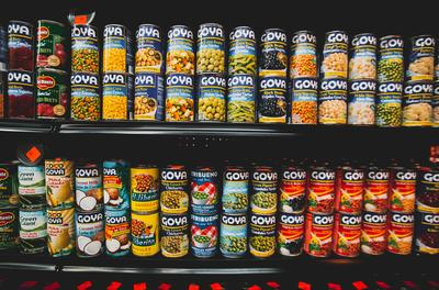 rows of canned foods at a grocery store