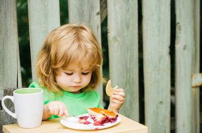child eating a meal with concentration