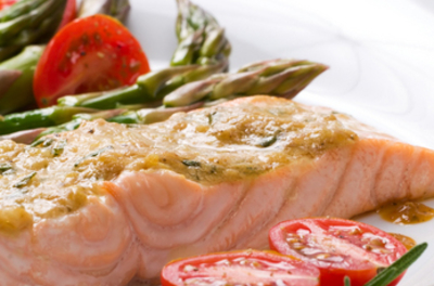 Salmon, tomatoes, and asparagus on a plate