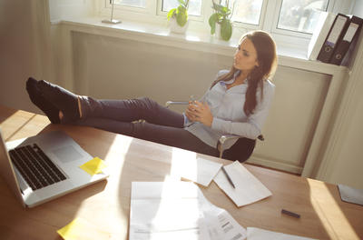 businesswoman relaxing at a table