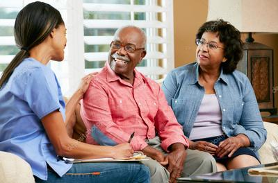 Nurse talking with middle age couple