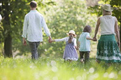 family walking in meadow